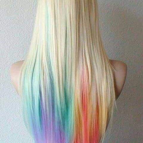 Now THIS is how you do rainbow ends. The colors blend so well with her natural hair!