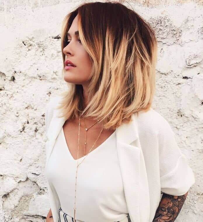 Warm blonde ombre bob with face-framing highlights