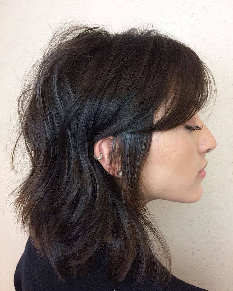 Layered Mid Length Haircut With Long Bangs