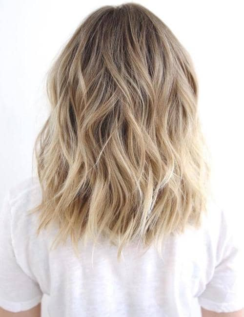 Sandy Blonde Surfer's Waves