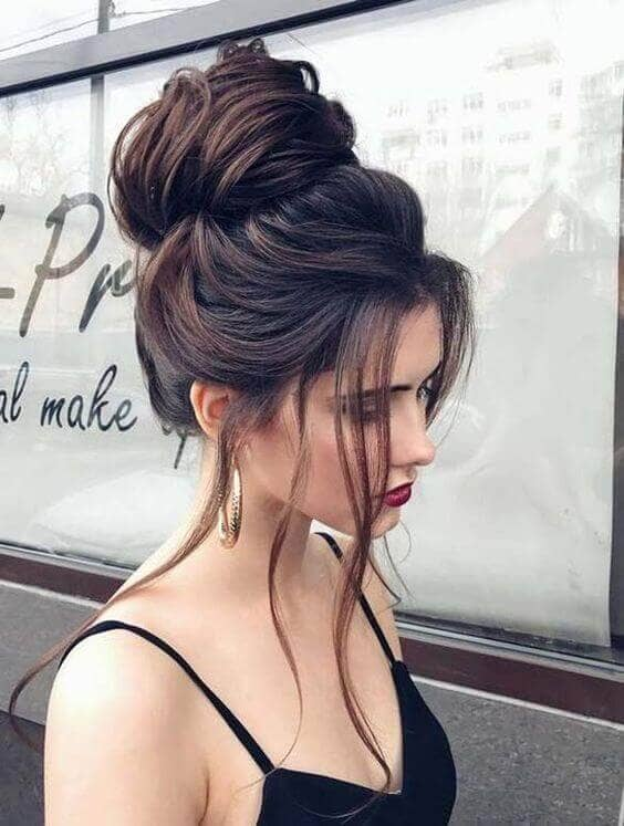 High Voluminous Bun With Face-framing Tendrils (Most Pinned Hairstyles Top Pick!)