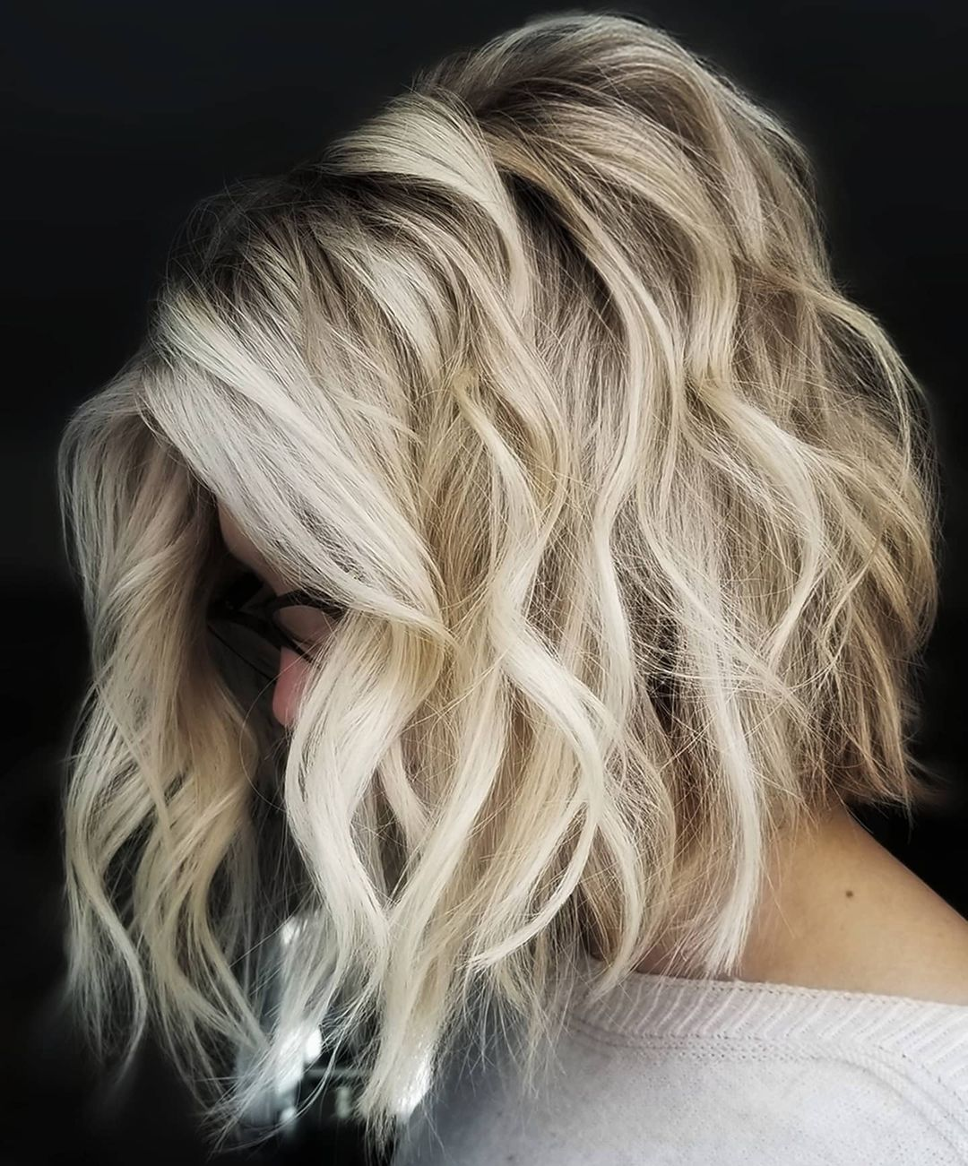 Platinum Blond Over-the-Shoulder Lob with Exposed Roots