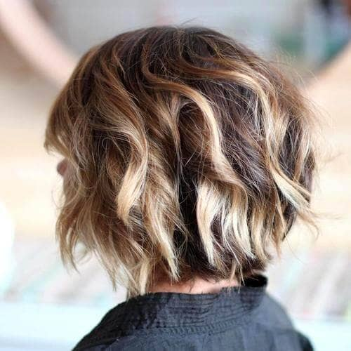 Thick, Curly Highlighted Chin-length Bob