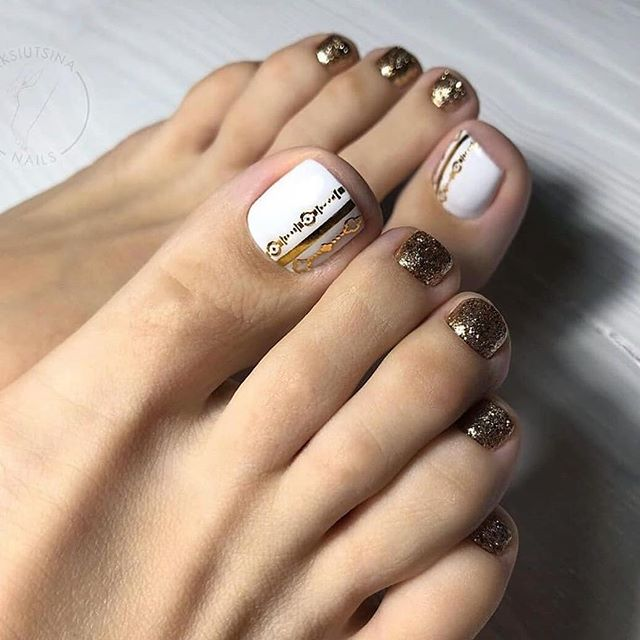 Modern Tribal White And Gold Nails