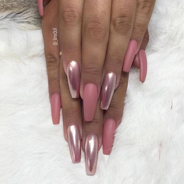 A Long Nail Design with Pink Flair