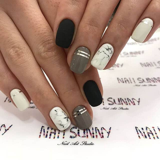 Marble, silver, and black high fashion nails