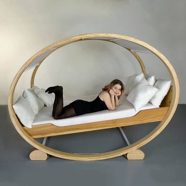 Open Frame Rocking Bed With Loads of Pillows