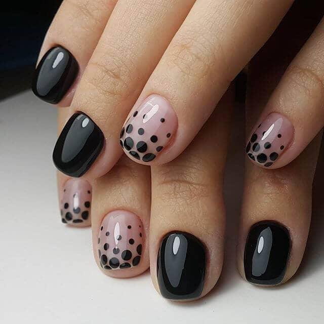 Polka dots with a twist- pink and black short nail design