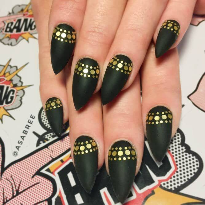 Queen of the Nile sharpened black and gold long nail design