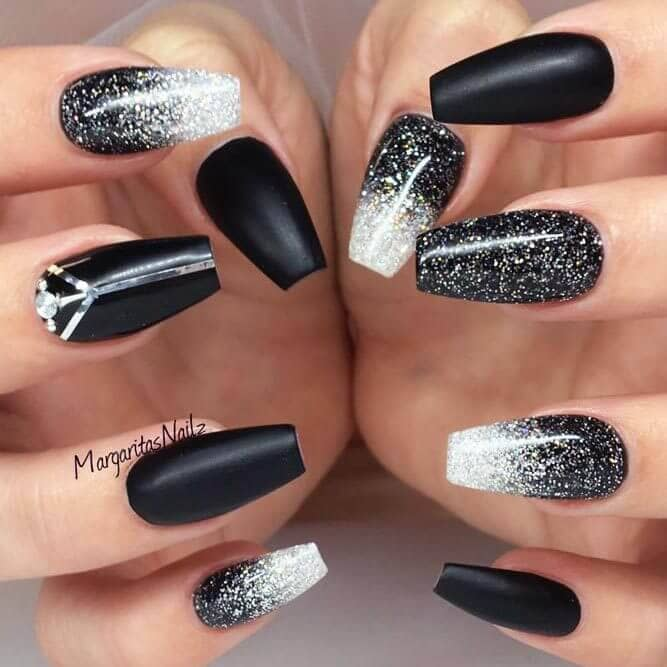 Galaxy inspired black and white spattered nails