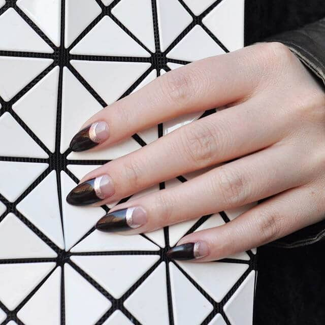 Trendy pointed black and silver nail design