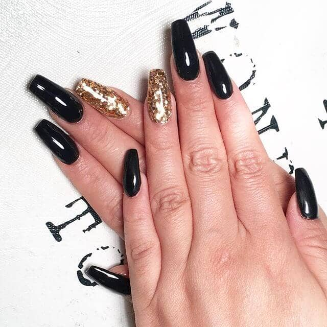 Gold Dust Woman- black with a gold accent long acrylic nails