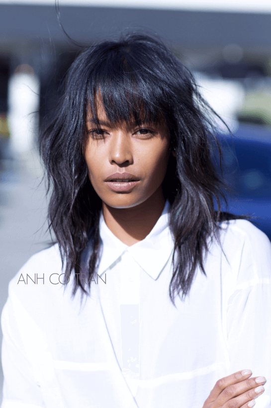 Spiky Asymmetrical Bangs Style with Loose Waves