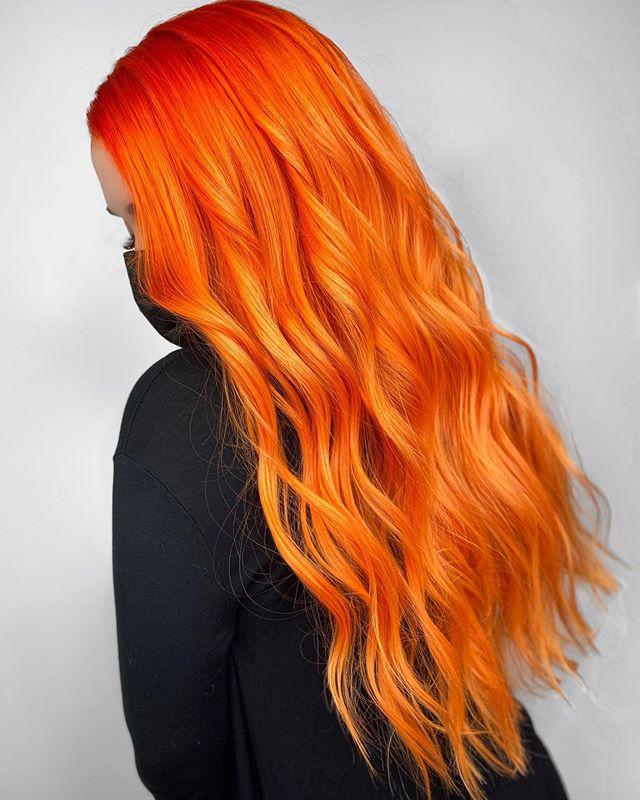 Vibrant Orange Hair With Soft Waves