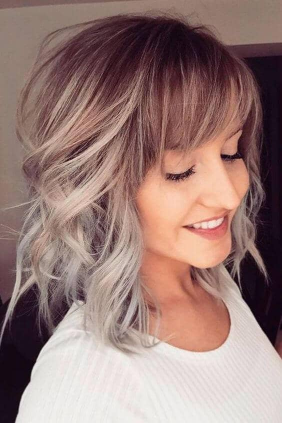 Sweet Curly Layered Haircut With Bangs