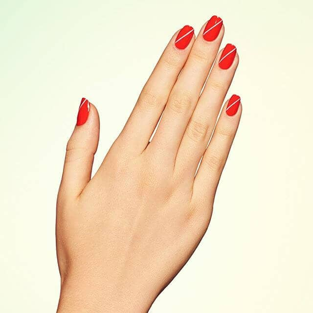Short Bright Red Nail With Cute White Accent