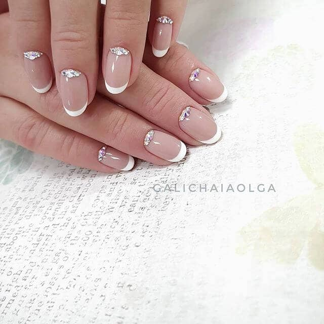 Stylish French Tip Manicure with Glitter