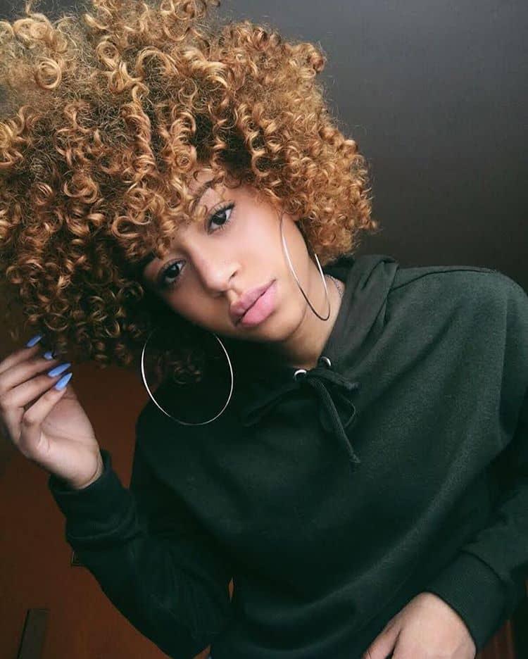 Trendy Tight Curls In A Curated Cut