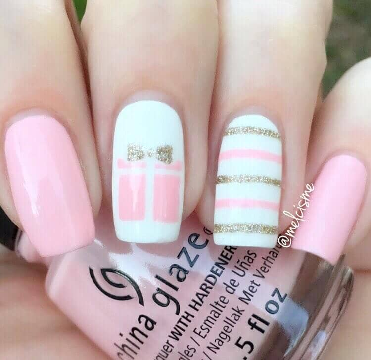 Adorable Pink Nails with Stenciled Accents