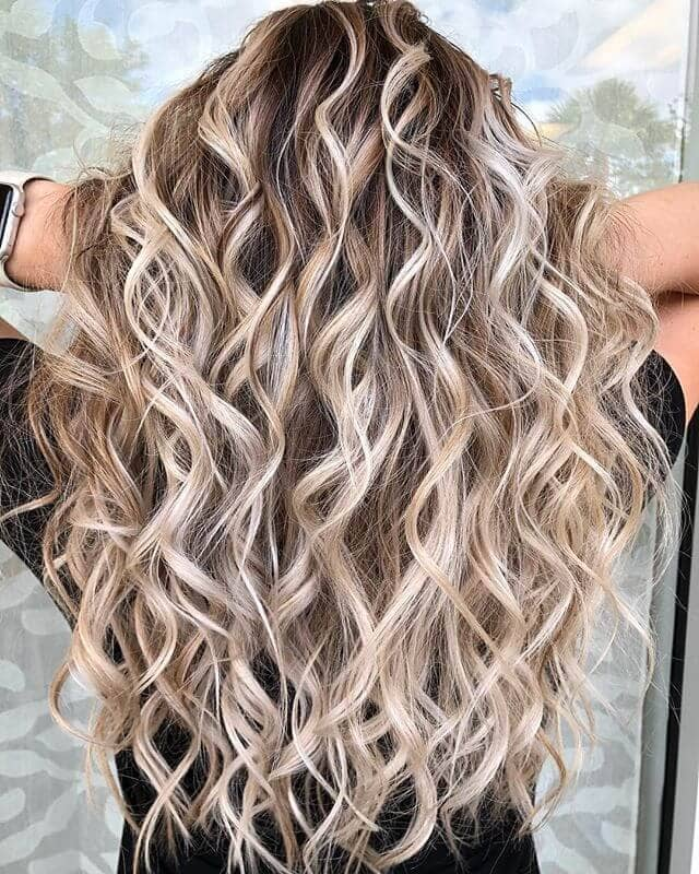 Perfectly Voluminous Blonde Spiral Curls