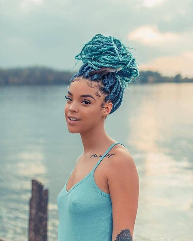 A Colorful Braided Topknot with Electric Blue Highlights