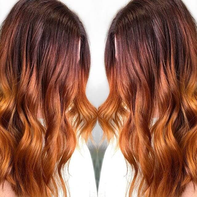 Long Red Ombre Hairdo with Bouncy Ends
