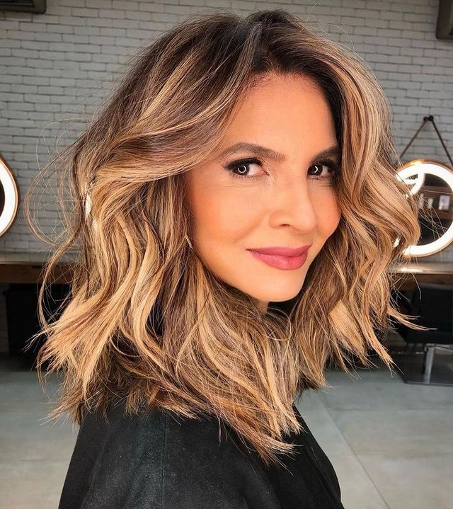 Broad Face Waves with a Blonde Ombre Short Cut