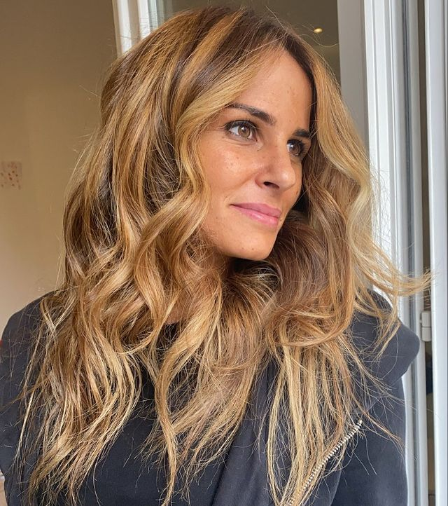 Long and Messy Hairstyle with Dark Blonde and Brunette Hues