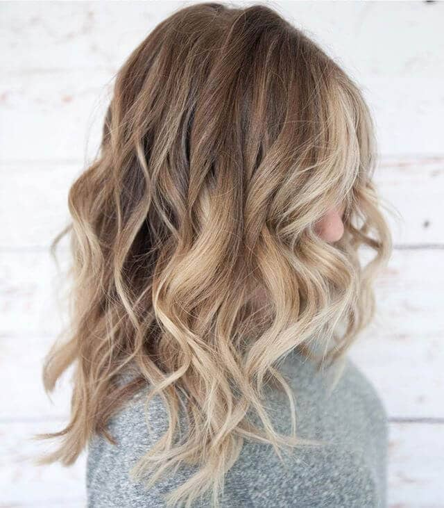 Full Wavy Layers with Streaks of Blonde and Brown