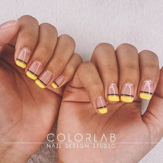 Shiny Clear Nails with Yellow Tips
