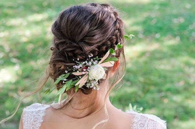 Braided Crown And Bun With Floral Feature