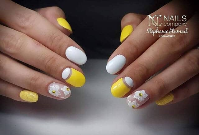 Yellow and White Nails with Flower Details