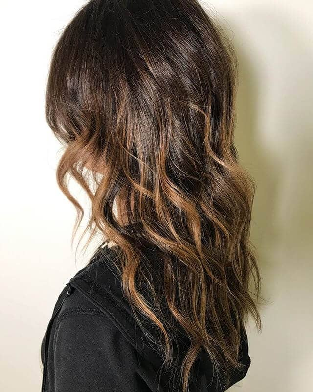 Tousled Brunette Layers with Streaky Caramel Highlights