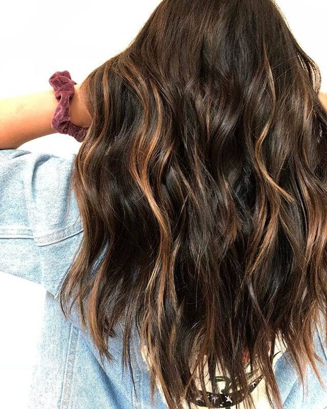 Dark Brown Hairstyle With Barely There Waves