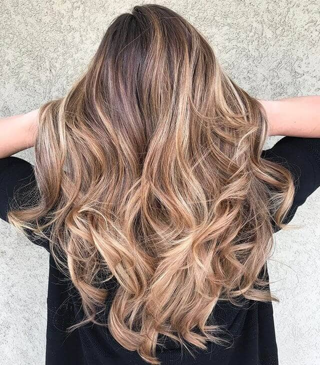 Thick Curls With Medium Blond Highlights