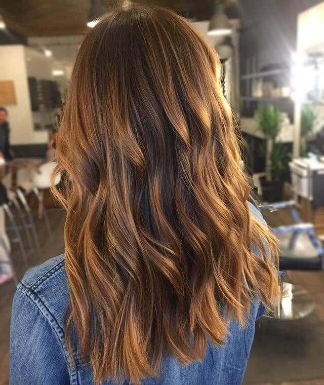 Caramel Shoulder-length Curly Cues with Highlights