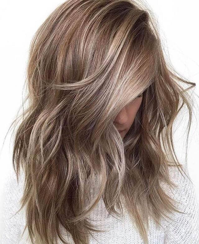 Deep Side Part Swept Natural Blond Curls
