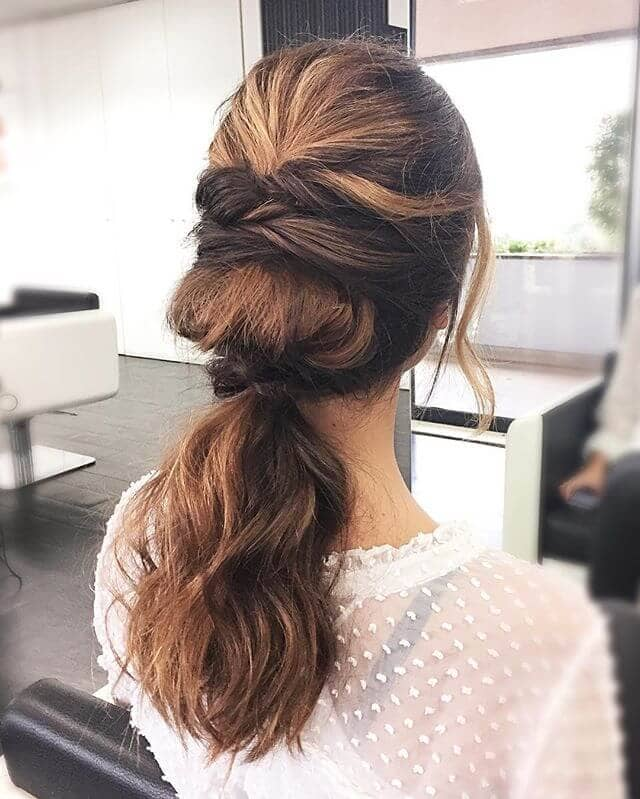 Double Twisted Flipped Ponytail Hairstyle