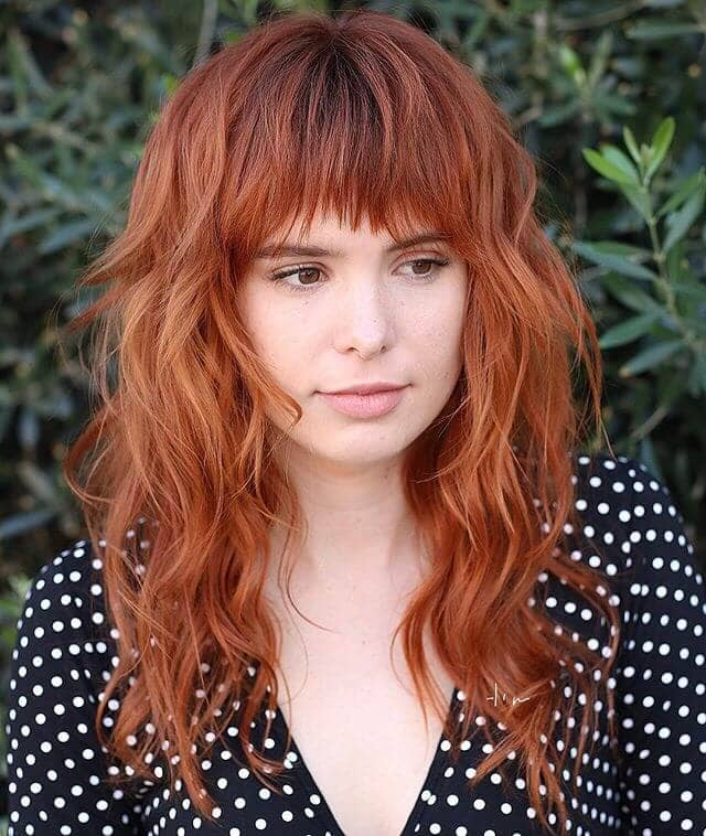 Cute and Coy Bangs With Uneven Ends