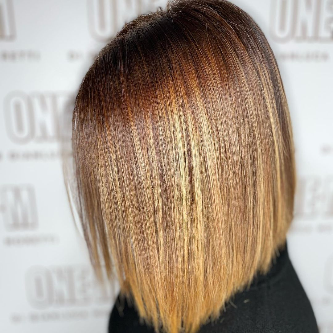 Undefined Straight Bob Hairstyle with Deep Amber Highlights