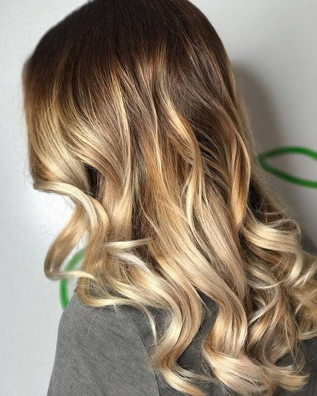 Golden Beige Blonde Highlights in Loose Curls