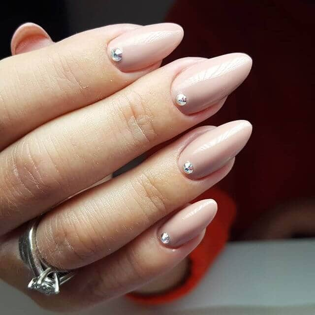Porcelain Pink with Single Stones Nail Ideas