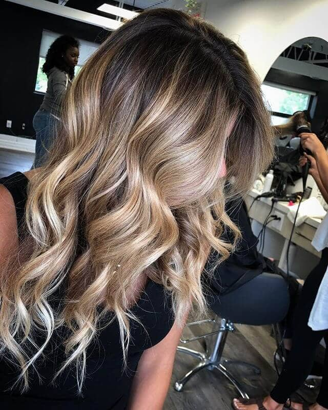 Cool Frosted Blonde Heavy Highlights in Dark Hair