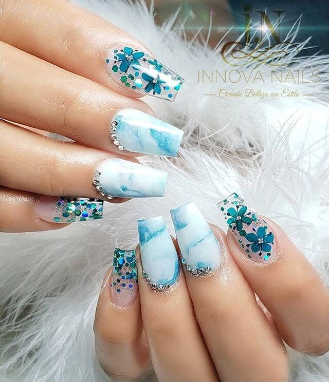 Translucent Glittery Blue Marble Nail Look