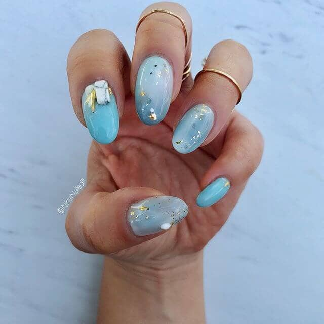 Decked out Aquamarine Swirled Nails
