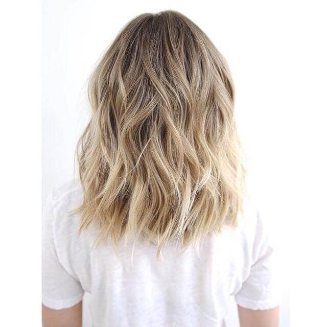 Breezy Mid-length Razor-cut Blond Highlights