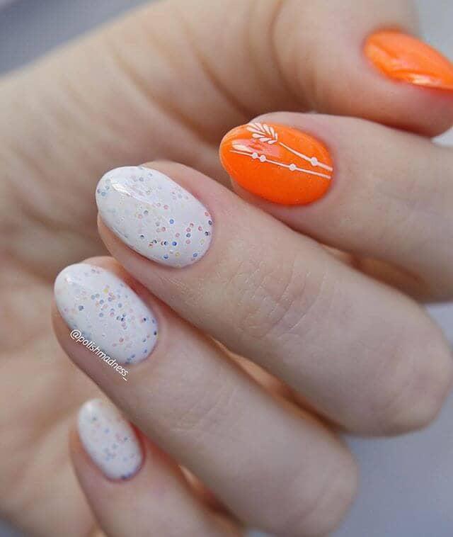 Confetti White Nails with Bright Orange Decorated Accents