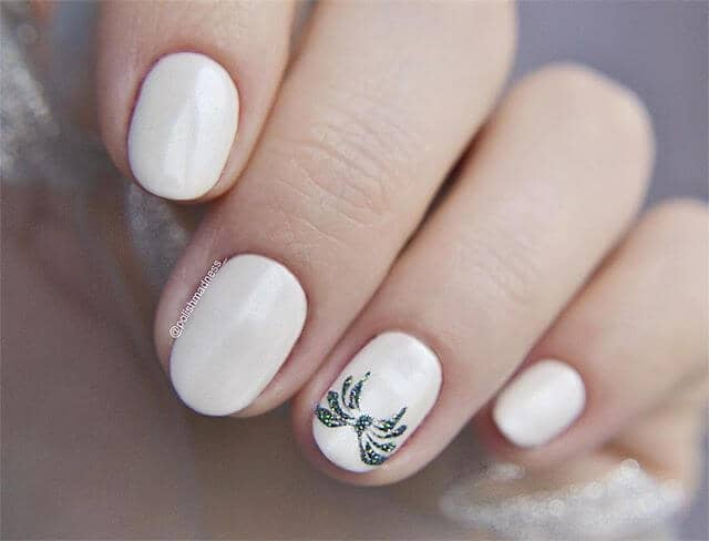 Lovey White Nails with a Glistening Bow