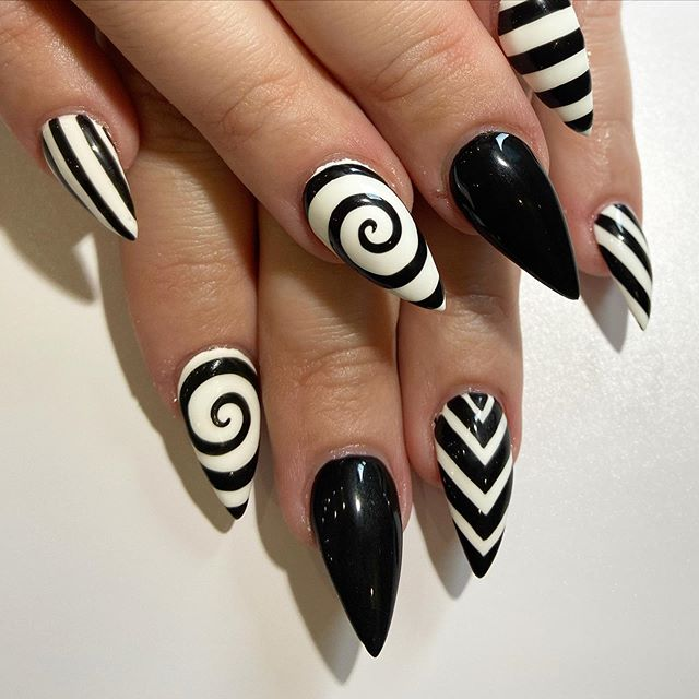 Contrasting Black-White Pattern Stiletto Nails