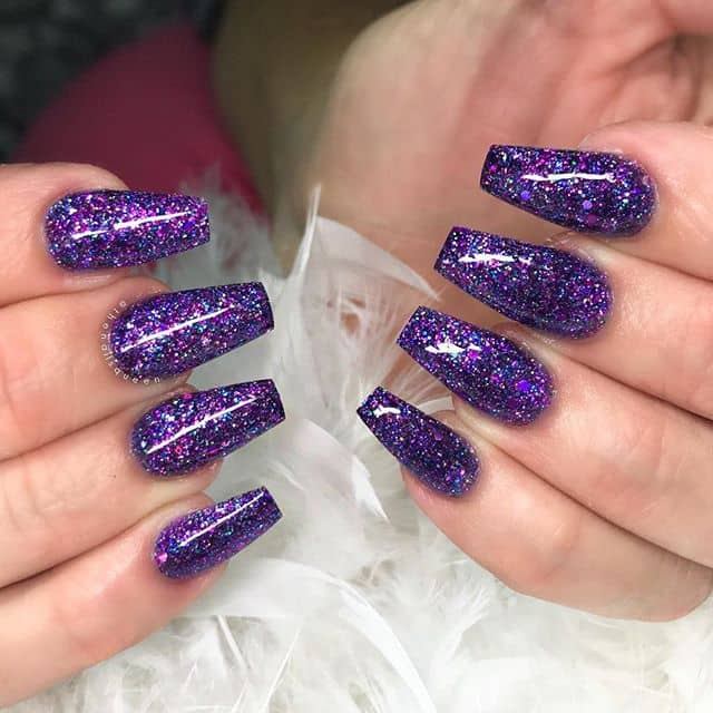 Magical Purple Glittery Galaxy Nails